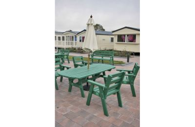 Extended-Table-and-Sloper-Chairs-Green-920x600